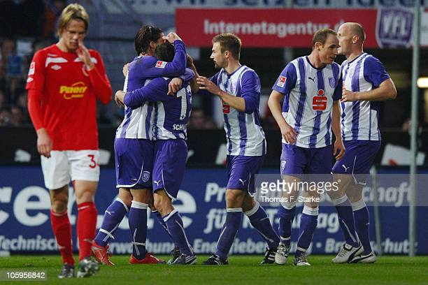 Jules Reimerink of Cottbus looks dejected while players of Osnabrueck celebrate their team's first goal during the Second Bundesliga match between...