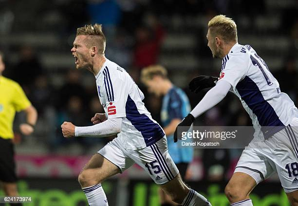 Jules Reimerink of Osnabrueck celebrates his team's first goal with team mate Robert Kristo during the third league match between VfR Aalen and VfL...