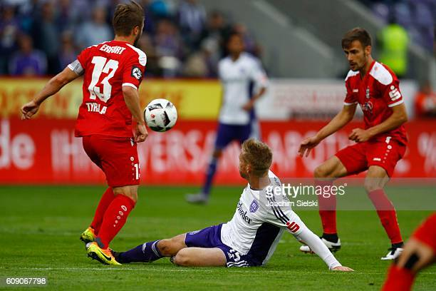 Jules Reimerink of Osnabrueck challenges Sebastian Tyrala and Liridon Vocaj of Erfurt during the third league match between VfL Osnabrueck and RW...