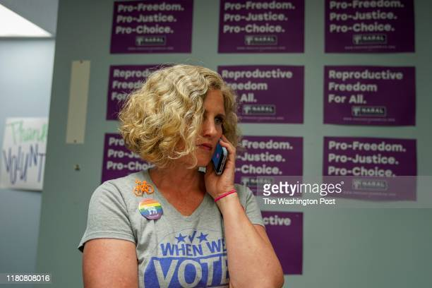 Juli Briskman the Democratic nominee for Supervisor of Loudoun County's Algonkian District takes a phone call in her campaign office as she prepares...
