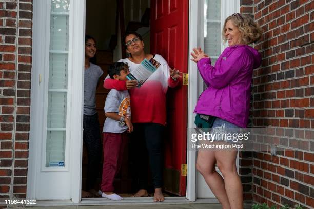 Juli Briskman the Democratic nominee for Supervisor of Loudoun County's Algonkian District chats with Saira Sufi C daughter Leena Rasheed and son...
