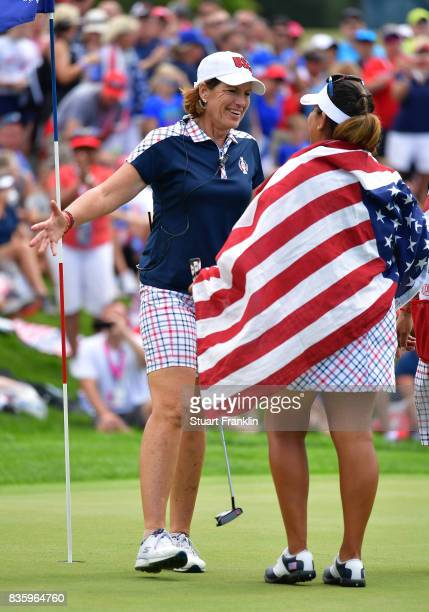 Juli Inkster Captain of Team USA celebrates with Lizette Salas on the 18th hole during the final day singles matches of The Solheim Cup at Des Moines...