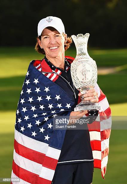 Juli Inkster captain of team USA holds the Solheim Cup trophy after the final day of The Solheim Cup at St LeonRot Golf Club on September 20 2015 in...