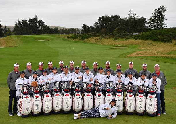 Juli Inkster Captain of Team USA poses with her team of players and their caddiea for the official team photo during a practice round prior to the...