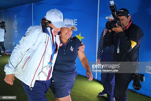 Juli Inkster captain of the United States Team an Lizette Salas walk to the first tee during the Sundays single matches in the 2015 Solheim Cup at St...
