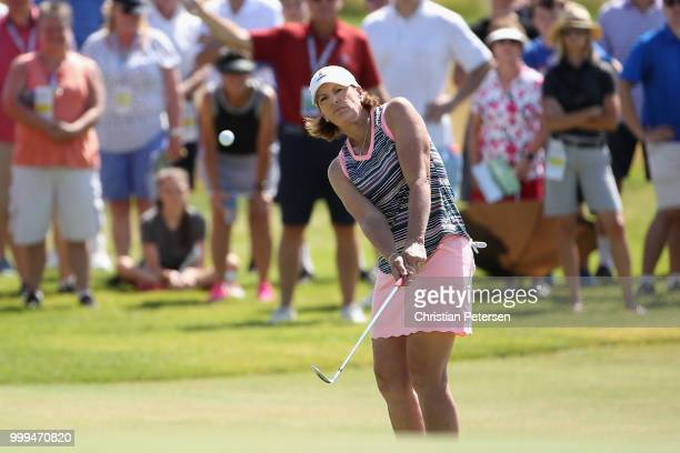 Juli Inkster chips onto the fourth green during the final round of the US Senior Women's Open at Chicago Golf Club on July 15 2018 in Wheaton Illinois