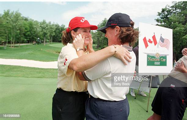 Juli Inkster embraces Gail Graham after their match concluded on the 14th hole AJ Eathorne sits on her bag on the 6th green Kane and Mallon embrace...