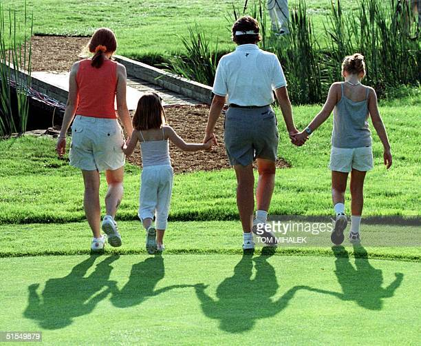 Juli Inkster of Los Altos California walks off of the 10th green holding the hands of her daughters Hayley 10 and Cori 6 from and Christina England...