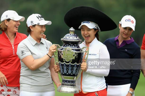 Juli Inkster of the United States Se Ri Pak of Korea Sei Young Kim of Korea and Lorena Ochoa of Mexico hold the Lorena Ochoa Match Play Trophy after...