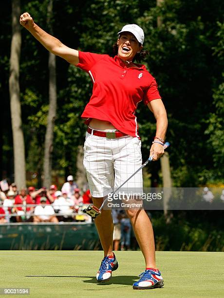 Juli Inkster of the US Team celebrates her birdie putt on the 16th green during the Sunday singles matches at the 2009 Solheim Cup at Rich Harvest...
