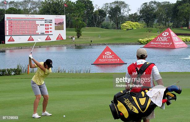 Juli Inkster of the USA plays her second shot on the 18th hole during the third round of the HSBC Women's Champions at the Tanah Merah Country Club...
