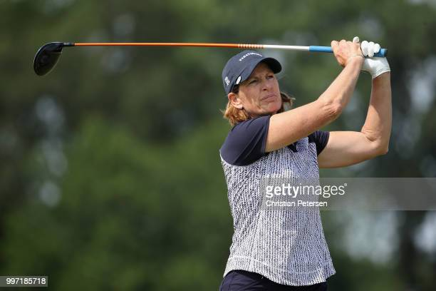 Juli Inkster plays a tee shot on the ninth hole during the first round of the US Senior Women's Open at Chicago Golf Club on July 12 2018 in Wheaton...