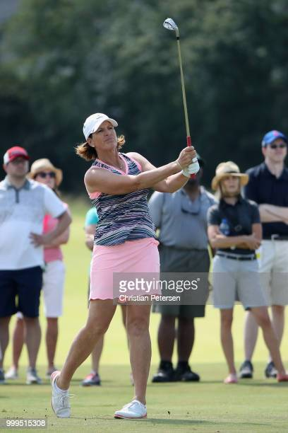 Juli Inkster plays her second shot on the sixth hole during the final round of the US Senior Women's Open at Chicago Golf Club on July 15 2018 in...