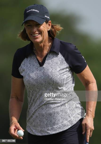 Juli Inkster prepares to putt on the seventh green during the first round of the US Senior Women's Open at Chicago Golf Club on July 12 2018 in...