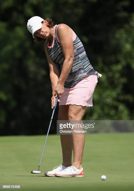 Juli Inkster putts on the seventh green during the final round of the US Senior Women's Open at Chicago Golf Club on July 15 2018 in Wheaton Illinois