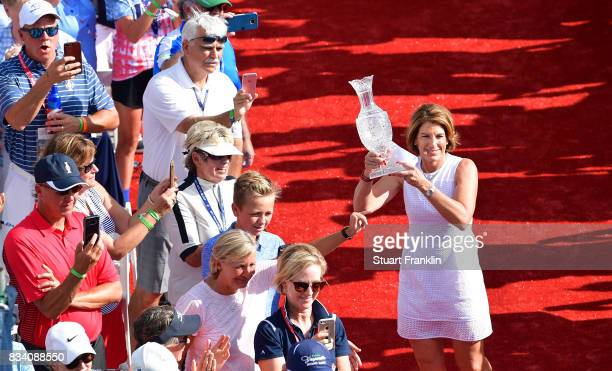 Juli Inkster Team USA Captain holds the Solheim Cup trophy during the opening ceremony prior to the start of The Solheim Cup at Des Moines Golf and...