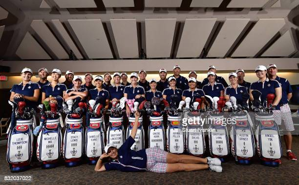 Juli Inkster Team USA Captain poses infron of her team and their caddies during a photocall prior to The Solheim Cup at the Des Moines Country Club...