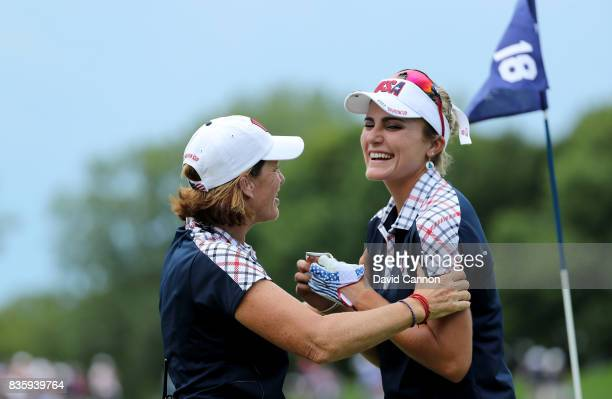 Juli Inkster the United States team captain embraces Lexi Thompson on the 18th green after Thompson had won the leading singles match against Anna...