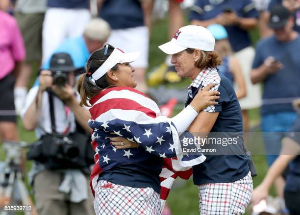 Juli Inkster the United States team captain embraces Lizette Salas after Salas had holed a putt on the 18th hole to win her match against Jodi Ewart...