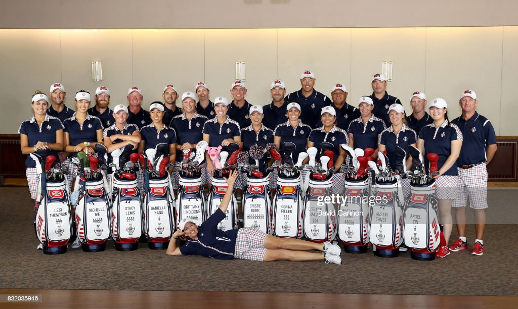 Juli Inkster the United States team captain enjoys a fun moment with her team and caddies at the official photo-call during practice for the 2017 Solheim Cup Matches at Des Moines Country Club on August 15, 2017 in West Des Moines, Iowa.