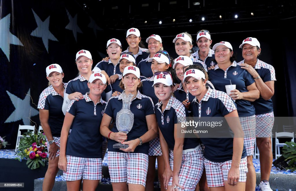 Juli Inkster the United States team captain holds the Solheim Cup with her victorious team at the closing ceremony after the final day singles matches in the 2017 Solheim Cup at the Des Moines Golf Country Club on August 20, 2017 in West Des Moines, Iowa.