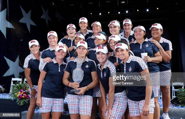 Juli Inkster the United States team captain holds the Solheim Cup with her victorious team at the closing ceremony after the final day singles...