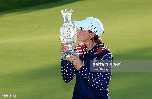 Juli Inkster victorious United States Team captain proudly holds the Solheim Cup trophy after the closing ceremony during the final day singles...