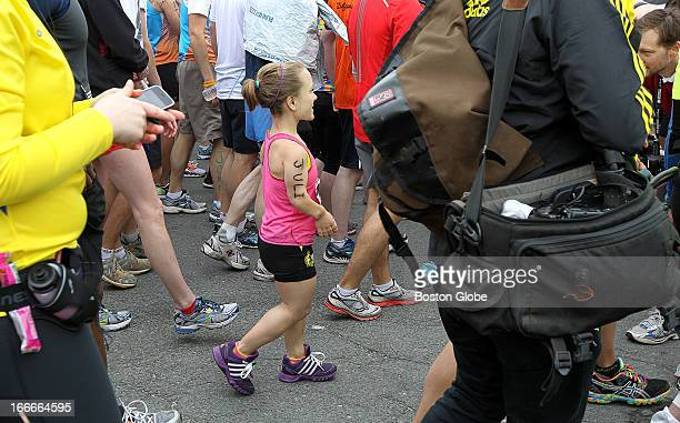 Juli Windsor of the South End enters the third wave of the 117th Boston Marathon on Monday April 15 2013 She and John Young not pictured are the...