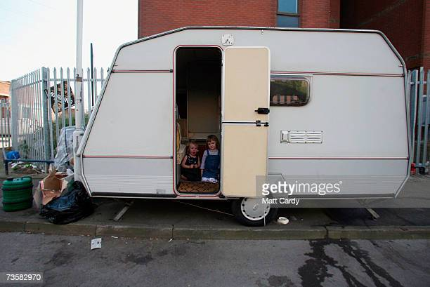 Julia 4 and her sister Shannon sit in the doorway of their caravan on the Clays Lane travellers site on March 15 2007 in London The residents of the...