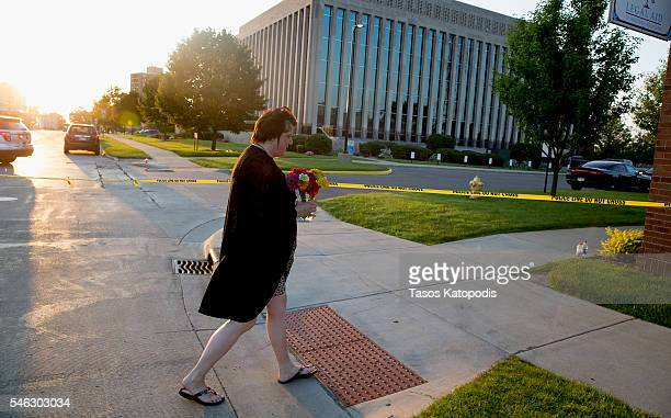Julia Ann Smith former employee at Berrien County Courthouse brings flowers to the site where several people where shot this afternoon on July 11...