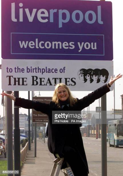 Julia Baird half sister of Beatle John Lennon unveils the first road sign in Liverpool to welcome visitors to the birthplace of the sixties pop group...