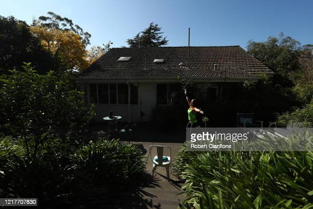 Julia Basa leads an online ZUMBA Fitness session from her backyard on April 09 2020 in Melbourne Australia ZUMBA Fitness is a nonstop cardio workout...