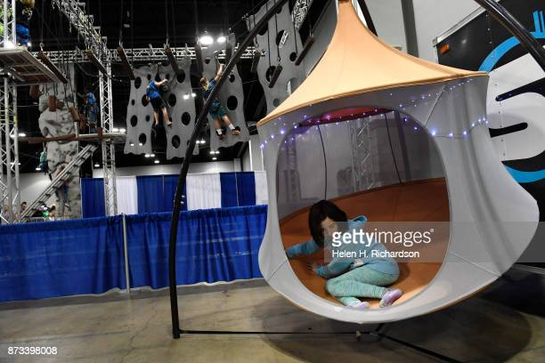 DENVER CO NOVEMBER 12 Julia Beam of Denver swings in a TreePod tent on display at during the 26th annual Colorado Ski and Snowboard Expo at the...