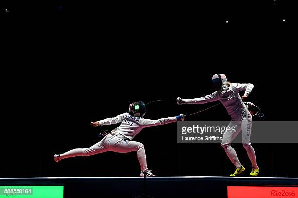 Julia Beljajeva of Estonia competes against Violetta Kolobova of Russia during the Women's Epee Team Bronze Medal Match bout on Day 6 of the 2016 Rio...