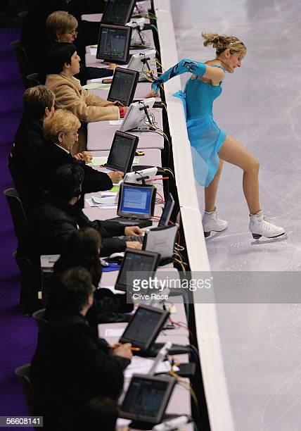 Julia Beloglazova of Ukraine crashes into the judges during the Pairs Short program at the ISU European Figure Skating Championships on January 17...