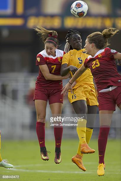 Julia Bingham and Ally Prisock of the University of Southern California and Michaela Abam of West Virginia University battle for the ball during the...