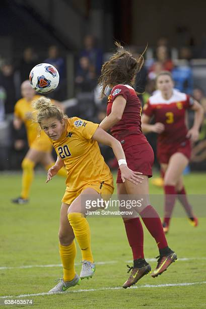 Julia Bingham of the University of Southern California and Hannah Abraham of West Virginia University battle for the ball during the Division I...