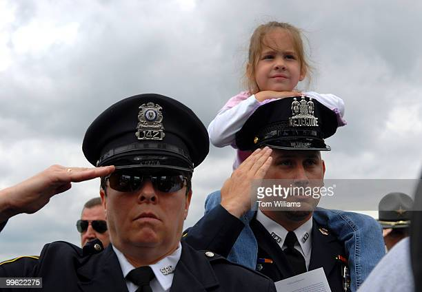 Julia Boris sits on the shoulders of her father Det Greg Boris of the Baltimore PD at the 25th Annual National Peace Officers' Memorial Service Det...