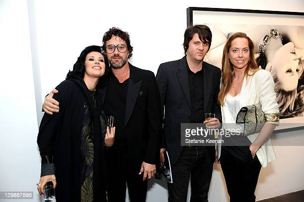"Julia Brown, Jonathan Brown, Orian Williams and Mia Fenwick attend Bryan Ferry ""Olympia"" At Michael Kohn Gallery Opening Reception at Michael Kohn..."