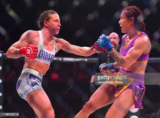 Julia Budd and Cris Cyborg exchange blows during their featherweight world title fight at The Forum on January 25 2020 in Inglewood California Cyborg...