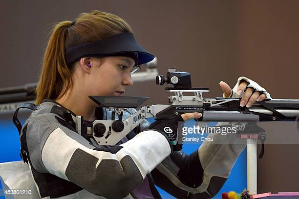 Julia Budde of Germany prepares to shoot during the 2014 Summer Youth Olympic Games Day 3 of the Girls 10m Air Rifle Final at the Fangshan Shooting...
