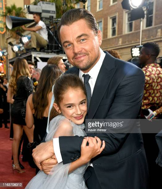Julia Butters and Leonardo DiCaprio arrive at the premiere of Sony Pictures' One Upon A TimeIn Hollywood at the Chinese Theatre on July 22 2019 in...