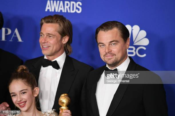 Julia Butters Brad Pitt and Leonardo DiCaprio pose in the press room during the 77th Annual Golden Globe Awards at The Beverly Hilton Hotel on...