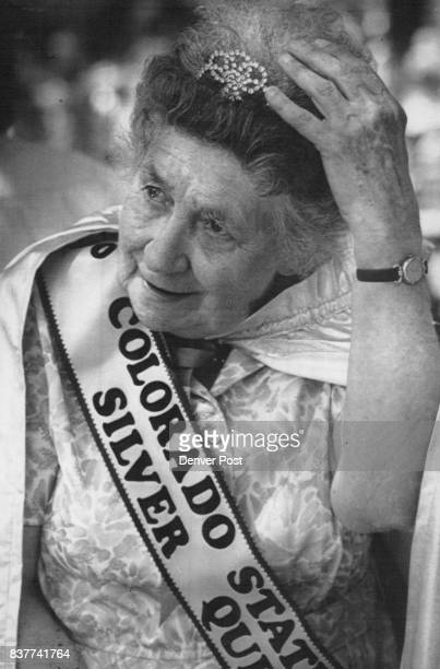 Julia Campbell of Denver Colorado State Fair Silver Queen touches her tiara during ceremonies Tuesday She presided over Senior Day activities 1990...