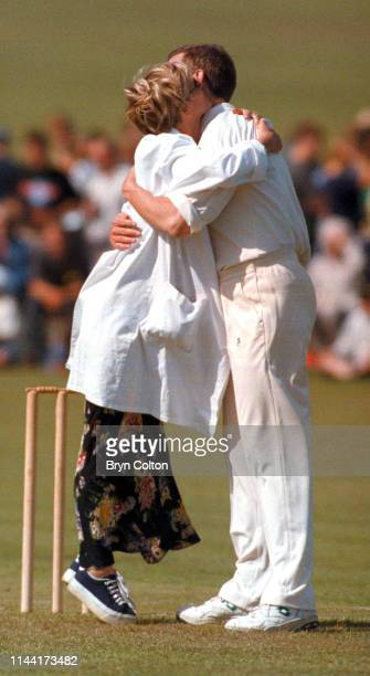 Julia Carling a British journalist television presenter and former wife of England rugby captain Will Carling left hugs Hugh Laurie a British actor...