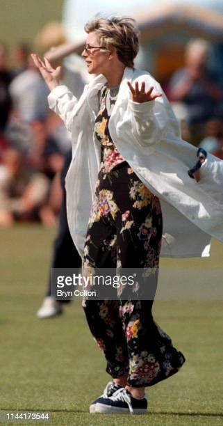 Julia Carling a British journalist television presenter and former wife of England rugby captain Will Carling gestures during a celebrity cricket...