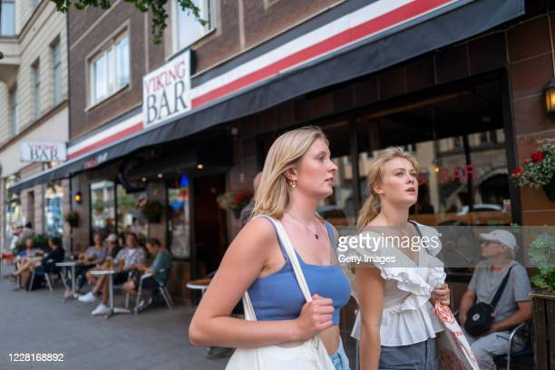 Julia Carlsson and Ellika Wohlfeil walk together after their first day back to school since the March shutdown on August 21, 2020 in Stockholm,...