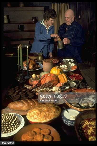 Julia Child and James Beard standing behind a table arrayed w autumnal foods while appearing on TV show Revolutionary Recipes