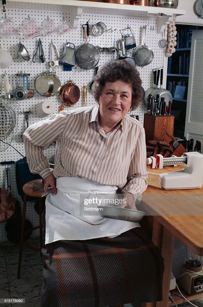 Julia Child poses 3/16 in her Santa Barbara kitchen. Her kitchen is small and square with a single window over the sink.