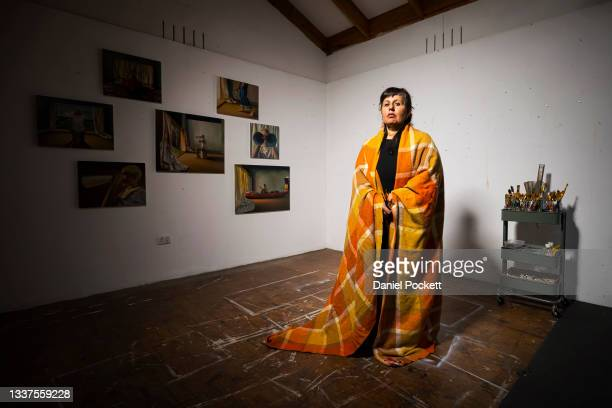 Julia Ciccarone poses for a portrait in her studio on September 01, 2021 in Melbourne, Australia. Julia Ciccarone self-portrait 'The sea within' has...